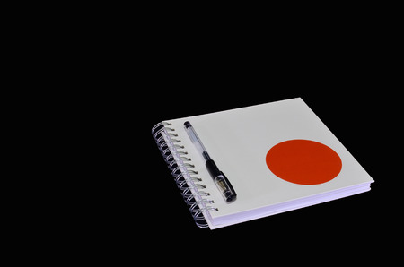 Isolated of white notebook with pen photo