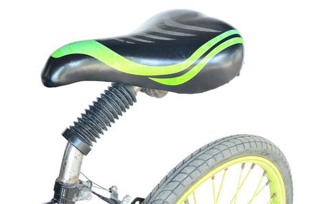 saddle: Isolated scene of aged bicycle with black saddle Stock Photo