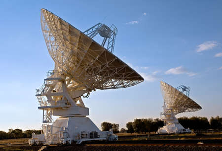 two compact array radio telescopes, photographed in the late afternoon Stock Photo
