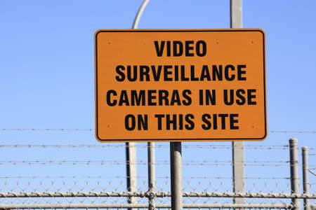 an orange warning sign, Video Surveillance Cameras in use on this site Stock Photo - 7505508