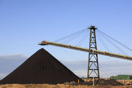 Coal Loading Conveyor Belt and a Pile of Coal at a Coal Mine photo