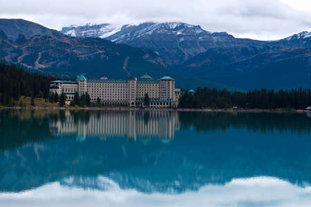 Lake Louise with Reflection on Water and Mountains in the background