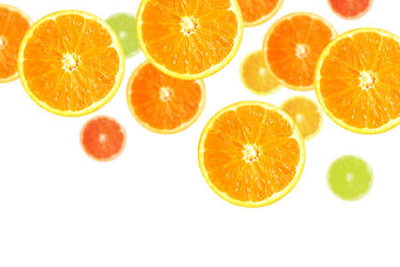 Juicy orange and lemon slices falling down, isolated in white