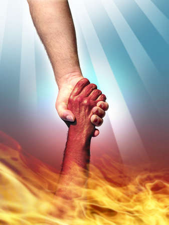 God making a pact with the Devil shaking hands. Stock Photo