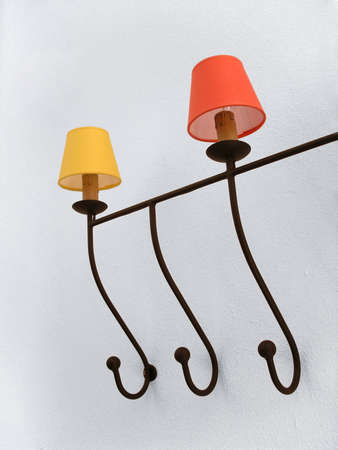 Two decorative lamps on a iron holder Stock Photo
