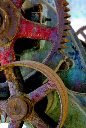 catenation: Rusty, old industrial gears in a deactivated machanical system.