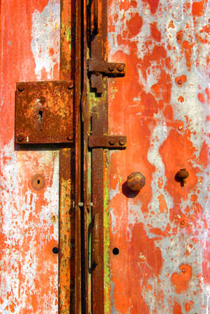 Old, rusty, abandoned metallic portal with locks and handle. photo
