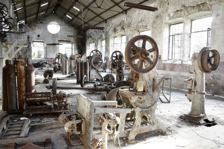 or rust: Old abandoned factory with useless rusty machinery.