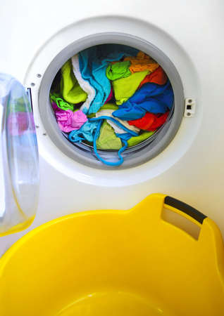 Close-up on a washing machine with clean colorful clothes Stock Photo - 2422827