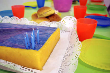 childrens birthday party: Snack table set in a childrens birthday party. Stock Photo