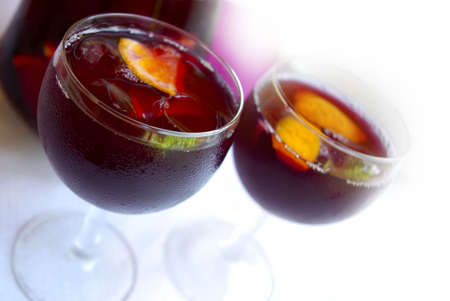 redwine: Two glass cups filled with fresh tasty sangria