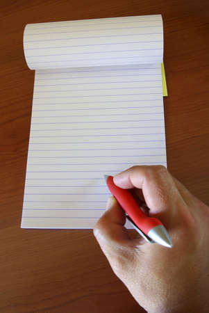 Male hand holding a pen writing notes in a notebook. Stock Photo - 2425743