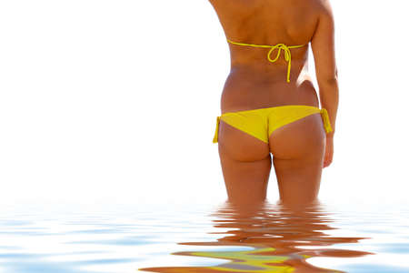 wet suit: Young woman in yellow bikini in clear and clean water