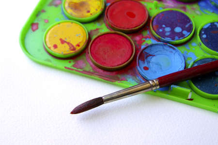 paintbox: Water-color paint-box and paint brush over white background