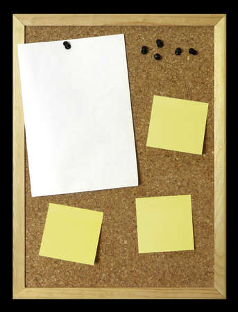 Corkboard with blank paper, black pins and post-it.