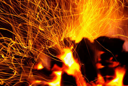 sparking: Photo of hot sparking live-coals burning in a barbecue
