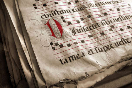 deteriorated: Old religious choir book with latin script from medieval age.