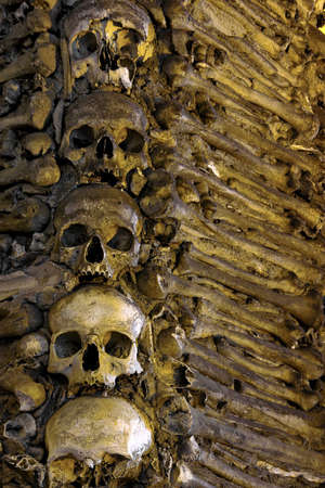 remains: Photo of a wall in a chapel fully couvered with human bones. Stock Photo