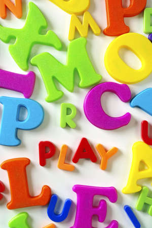 Macro composition of many colorful plastic toy letters Stock Photo - 2427003