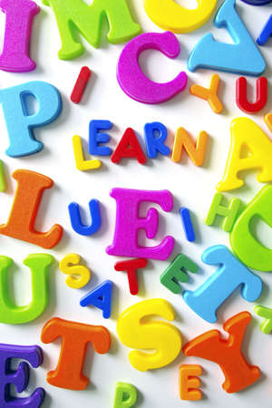 Macro composition of many colorful plastic toy letters Stock Photo - 2427063