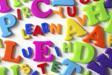 Macro composition of many colorful plastic toy letters and word LEARN Stock Photo - 2427052