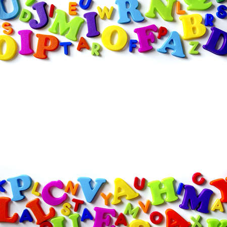 Macro composition of many colorful plastic toy letters photo