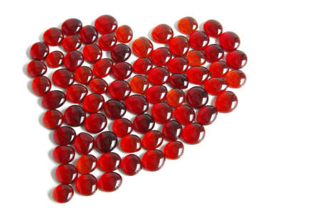 Photo of tens of little red glass gems forming a heart