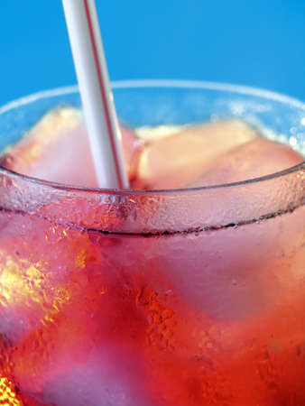 bartend: Close up of glass with cold drink and straw. Stock Photo