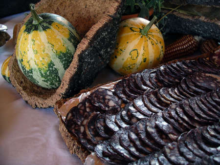 Korn: Table with pumpkins, cork, korn, and smoked sausage slices. Stock Photo