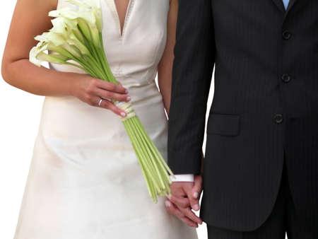Groom's black suit and bride's white wedding dress. Stock Photo - 2426803