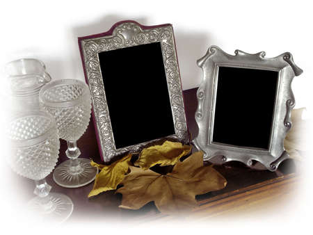 Two vintage silver photo frames and old glasses, surrounded with a white vignette. photo