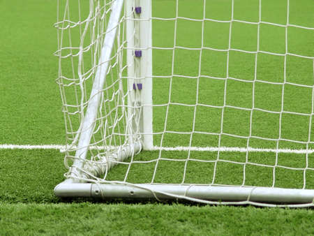 pitch: Detail of a goal net and white line in a soccer field