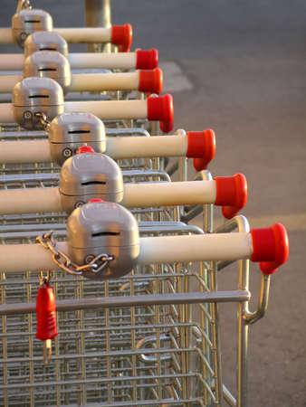 Row of shopping karts outside the supermarket. Stock Photo - 2426931
