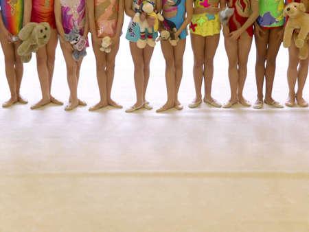Photo of a row of girl gymnasts in a gymnastics event. Banco de Imagens