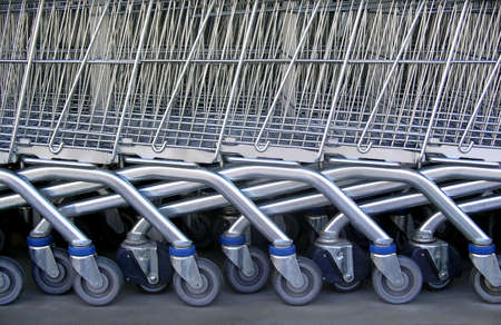 Detail of a row of supermarket karts tidy put together. Stock Photo - 2427158