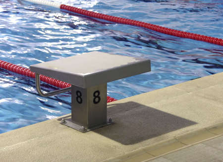 hydrophobia: Start position with number 8 in competition swimming pool Stock Photo