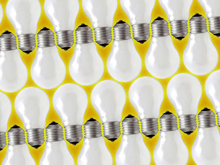 Composition of four rows of lamp bulbs over yellow background. Stock Photo - 2426903