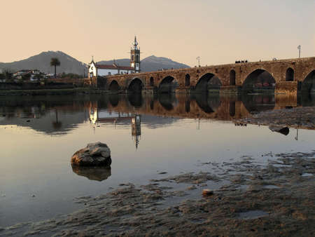lima province: Church and ancient bridge over river Lima, Portugal.
