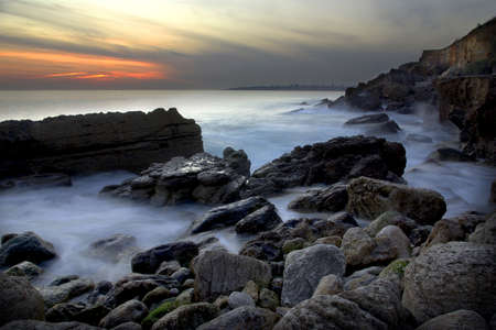 Dramatic coastline with the ocean in motion in the evening. photo