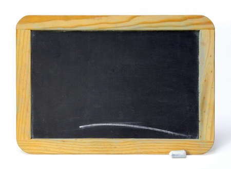 Small old chalkboard and piece of chalk over white background Stock Photo - 2548749