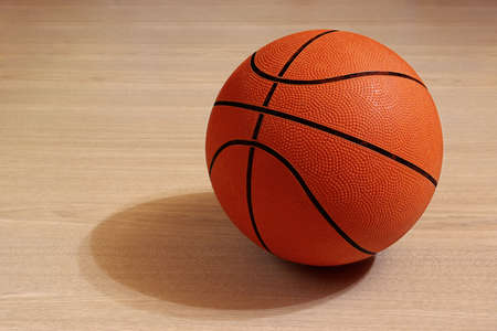 basketball tournaments: Photo of one basket ball in a wooden floor