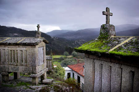 Ancient traditional Portuguese cereal keepers on top of a hill photo
