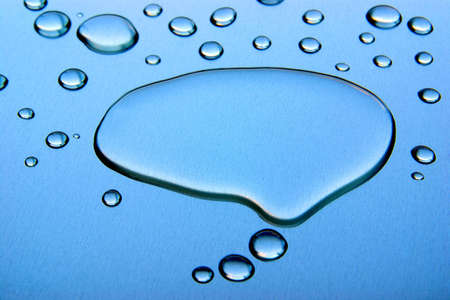 Comics thought bubble made out of water on a blue metallic surface
