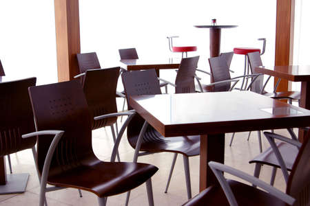 shop interior: Empty tables in a closed modern coffee shop