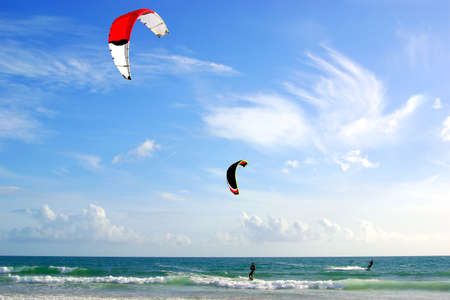Two kitesurfers and a beautiful blue sky photo