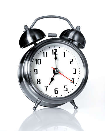 Old-fashion alarm clock ready to ring and wake everyone photo