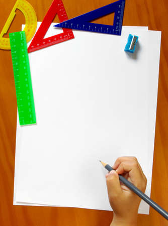 Colorful student gear and blank sheets of paper photo