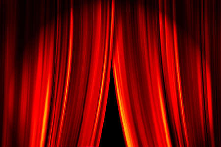 Theatre stage red curtains opening for a live performance