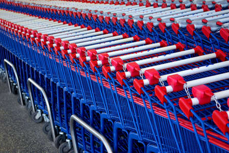 Detail of a rows of supermarket karts tidy put together. Stock Photo