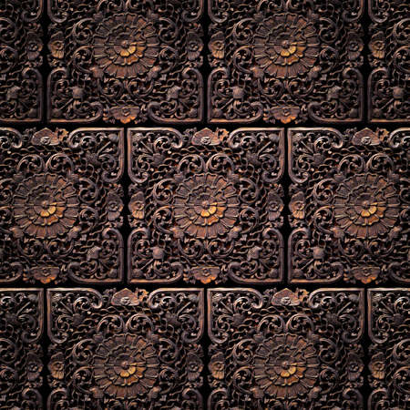 Pattern of tiles of a beautiful carved floral work photo